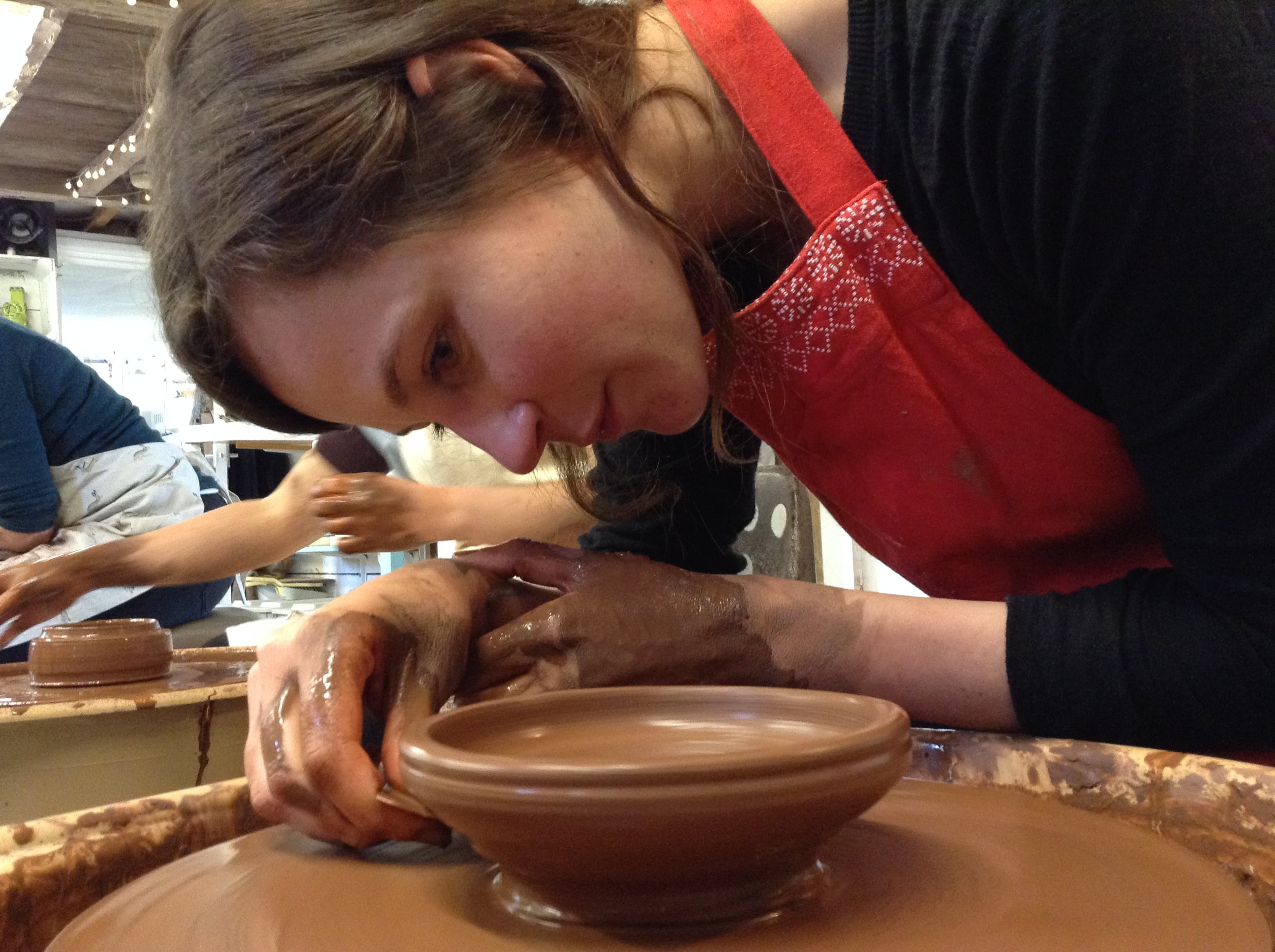 A lady creating some pottery Potter's Wheel Weekend Course