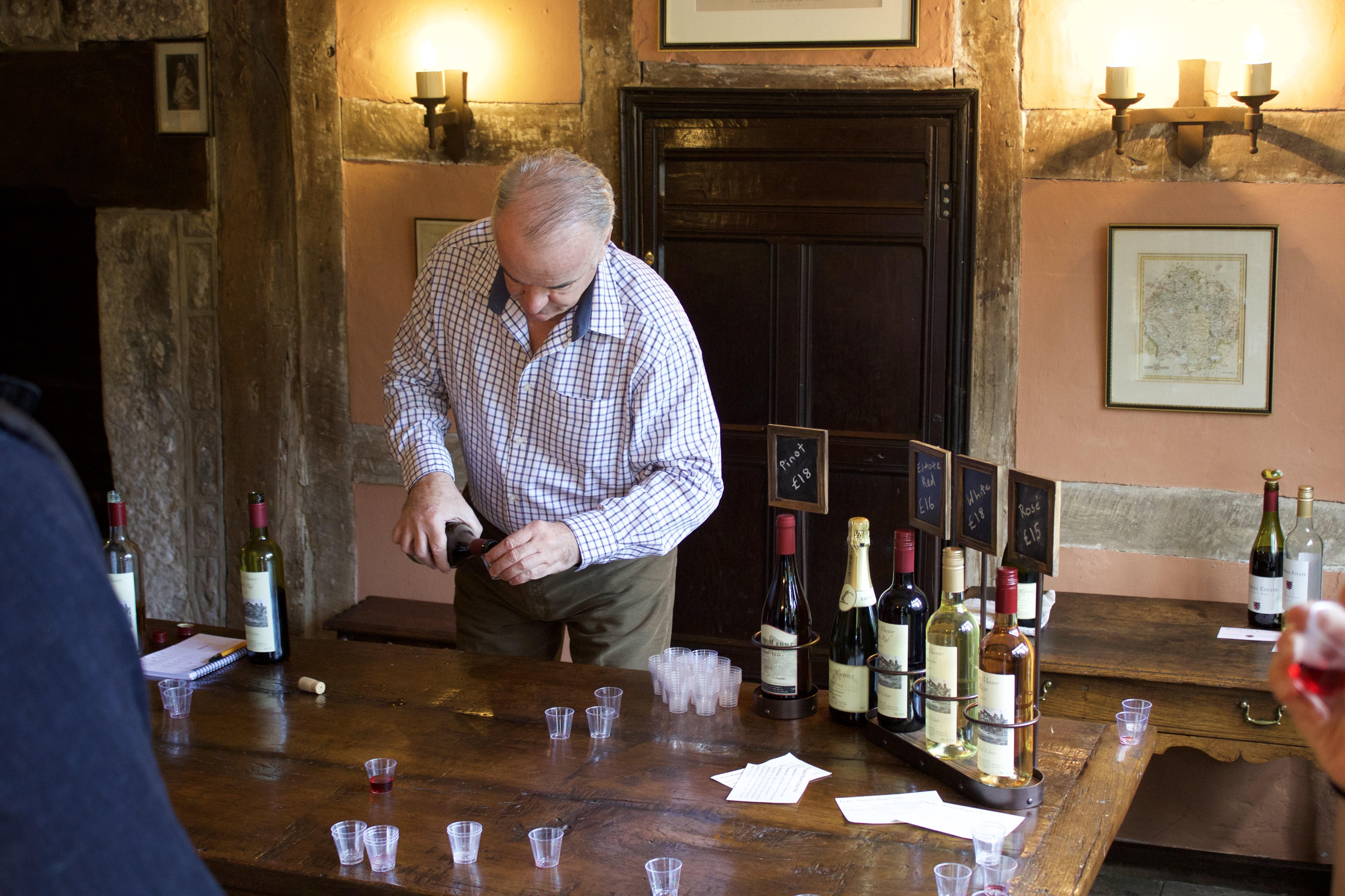 Jamie McIntyre serving wine at wythall estate tour