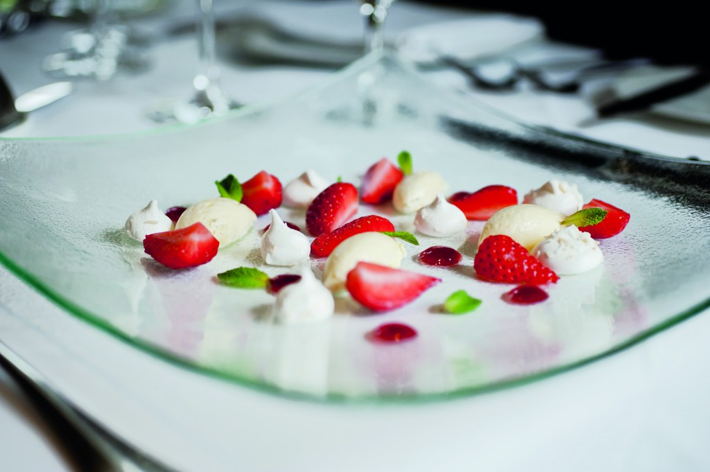 picture of strawberries and cream on a plate