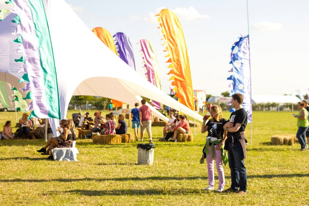 Photo showing festival goers drinking in the sun at Livestock Festival