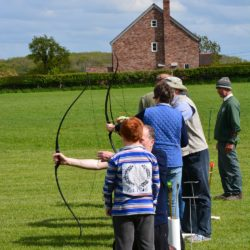 People playing archery in Herefordshire