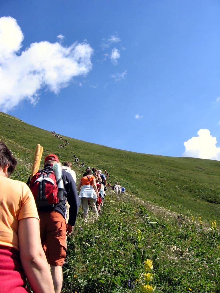 People on a hillside walking