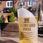 A glass of Stowfords Press