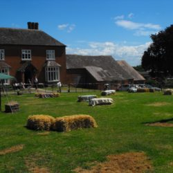 The Lawn at Huntlands Farm with bails to sit on at wedding party
