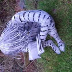 Seated with book - Welded metal garden sculpture